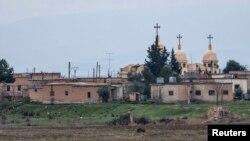 Sebuah gereja di Desa Abu Tina, Suriah utara yang baru saja direbut oleh kelompok militan ISIS (25/2).