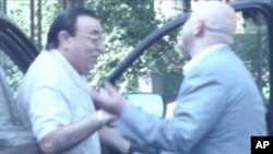 "FILE - This undated picture taken from video provided by Russian state television shows Russian mobster Aslan Usoyan, left, one of Russia's top crime lords who was gunned down Jan. 16, 2013, in Moscow. The contract-style killing drew renewed attention to the extensive and elaborate culture of the country's underworld figures, who call themselves ""Thieves-in-Law."""