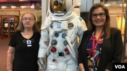 Sandra Cauffman, right, serves as deputy director of NASA's Earth Science division. She's shown at agency headquarters with her mother, María Jerónima Rojas, and an Apollo space suit.