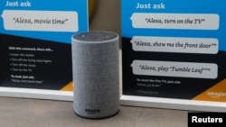 """FILE - Prompts on how to use Amazon's Alexa are seen in an Amazon """"experience center"""" in Vallejo, California, May 8, 2018. In an effort to counter possible sexist stereotypes, a team created a voice nicknamed Q that is designed to be perceived as neither male or female."""