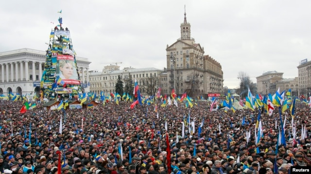Supporters of EU integration are seen at a rally earlier in the day at Independence Square in central Kyiv, December 8, 2013.