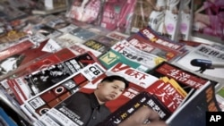 One of the magazines at a newspaper stand in Beijing highlights North Korea's new leader Kim Jong Un, December 30, 2011.