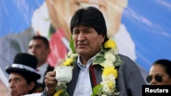 FILE - Bolivia's President Evo Morales attends the inauguration of multifamily buildings decorated by painter Roberto Mamani and built by a housing program government in El Alto, on the outskirts of La Paz, Bolivia, Feb. 15, 2016.