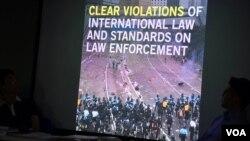 國際特赦組織香港分會在記者會上公報簡報發現警方6-12清場行動使用過份武力。(美國之音湯惠芸拍攝)