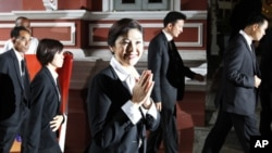 Thailand's first female Prime Minister Yingluck Shinawatra arrives for the first cabinet meeting at the Government House in Bangkok August 11, 2011.