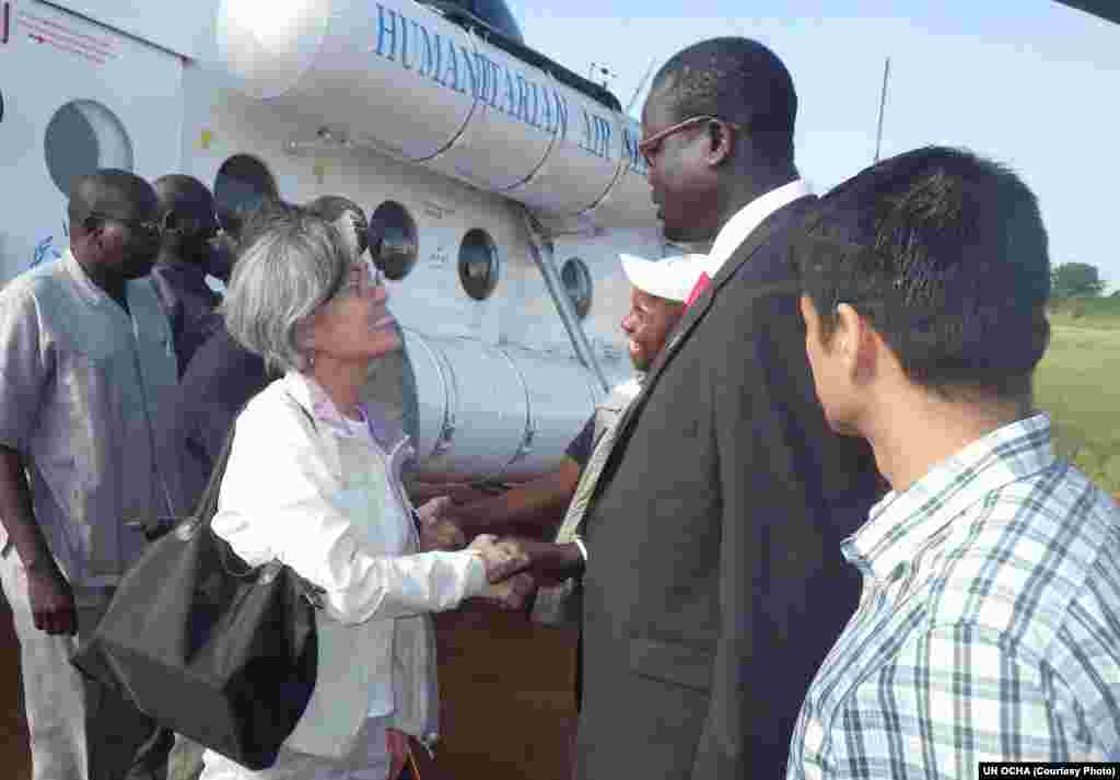 UN Assistant Secretary General Kyung-Wha Kang (L.) is welcomed to Bor, capital of Jonglei state in South Sudan, by Gabriel Deng Ajak, the Relief and Rehabilitation Commission Director for the state.