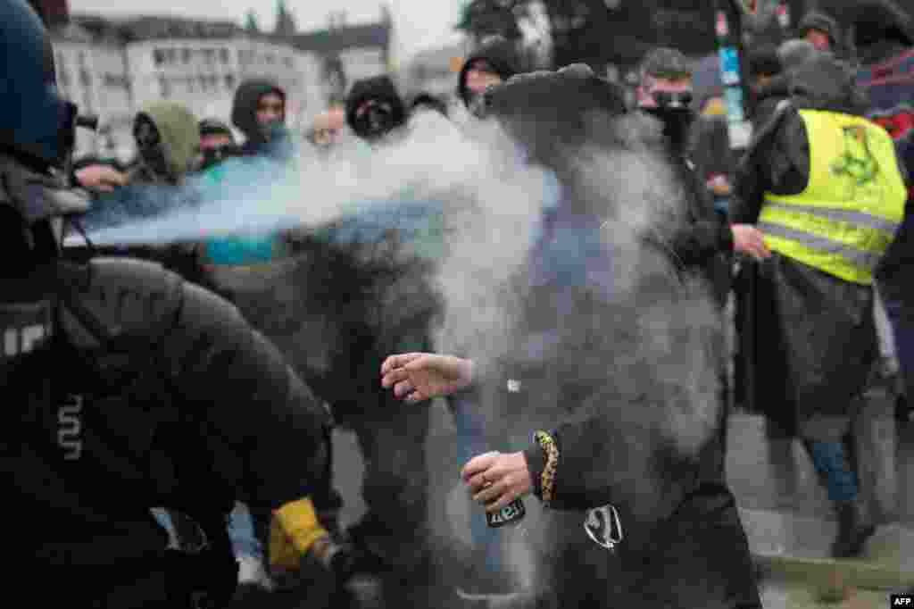 A woman reacts as tear gas is sprayed right into her face during a demonstration in Nantes, France.