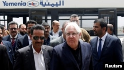 FILE - U.N. envoy to Yemen Martin Griffiths, center, arrives at Sanaa, Yemen, July 2, 2018.