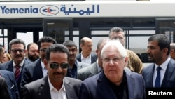 FILE - U.N. envoy to Yemen Martin Griffiths, center, arrives at Sana'a, Yemen, July 2, 2018.
