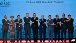 In this June 23, 2019, file photo, South East Asian leaders pose for a group photo during the opening ceremony of the ASEAN leaders summit in Bangkok, Thailand. (AP Photo/Gemunu Amarasinghe, File)