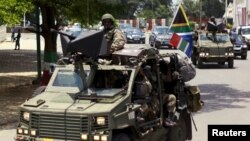 Military vehicles lead the way as South African President Jacob Zuma arrives as the head of an Africa Union-lead delegation in an attempt to broker dialogue to end months of violence in Burundi's capital Bujumbura, Feb. 25, 2016.