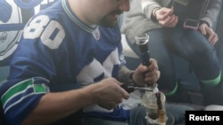 Seahawks fan smokes marijuana in car before watching Super Bowl XLVIII, Seattle, Washington, Feb. 2, 2014.