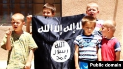Bosnian children with an Islamic State flag are seen in an IS video.
