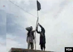 IS Khorasan group mounts a flag in tribal region of Afghanistan, Nov. 2, 2015.