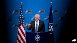 U.S. Defernse Secretary Jim Mattis talks to journalists during a news conference at the end of the second day of a meeting of the North Atlantic Council at a gathering of NATO defense ministers at NATO headquarters in Brussels, Belgium, Oct. 4, 2018.
