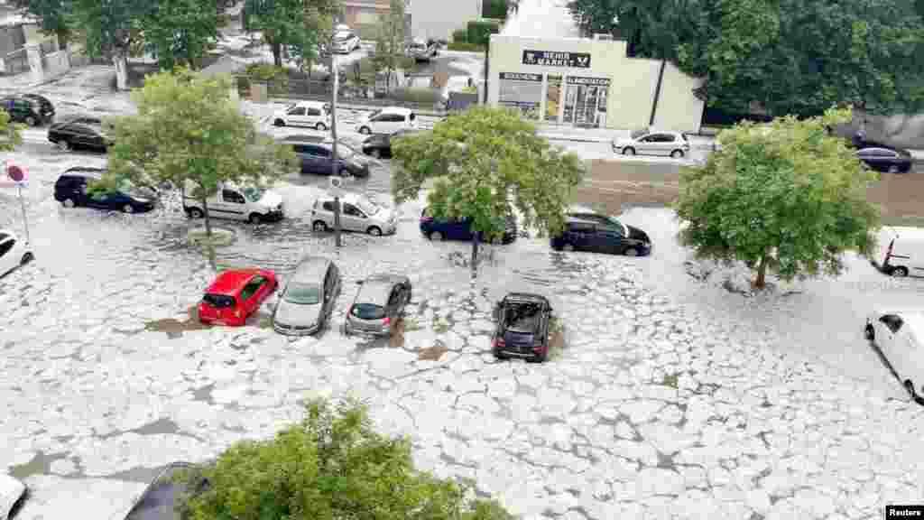 Hail flash-floods the streets in Decines-Charpieu near Lyon, France, June 23, 2021 in this still image taken from social media video. (Twitter @ant_steyer/Antoine Steyer)