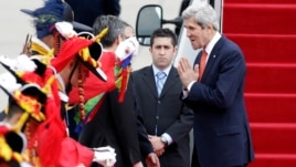 U.S. Secretary of State John Kerry, right, greets upon his arrival at Seoul military airport in Seongnam, South Korea, April 12, 2013.