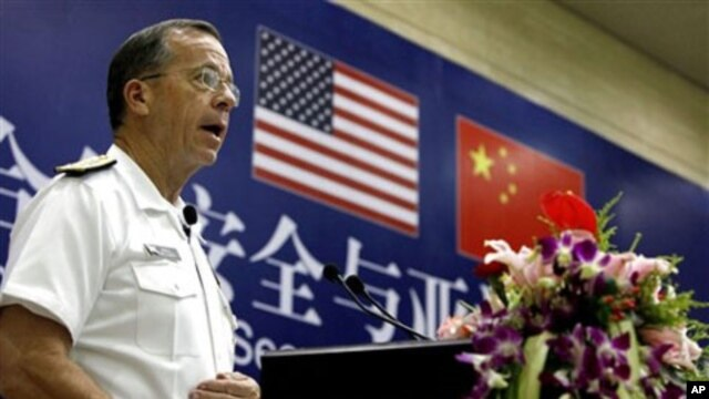 U.S. Navy Adm. Mike Mullen, chairman of the Joint Chiefs of Staff, speaks at the Renmin University in Beijing Sunday, July 10, 2011.