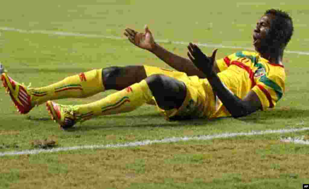 Mali's Modibo Maiga reacts after being fouled during their final African Cup of Nations Group D soccer match against Botswana at the Stade De L'Amitie Stadium in Libreville February 1, 2012.