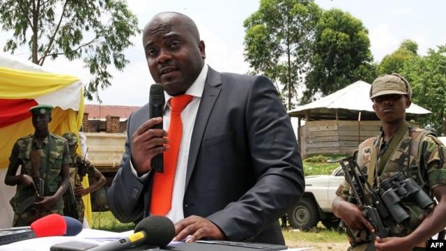M23 rebel leader Bertrand Bisimwa (C) is seen in a March 7, 2013, file photo.