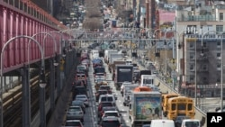 In this March 28, 2019 photo, traffic makes its way into Manhattan from Brooklyn over the Williamsburg Bridge in New York. A congestion toll that would charge drivers to enter New York City's central business district is a first for an American city. (AP Photo/Mary Altaffer)