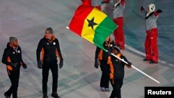 Akwasi Frimpong of Ghana carries the national flag during the opening ceremony of the Pyeongchang 2018 Winter Olympics in South Korea, Feb. 9, 2018.