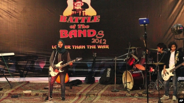Members of Indian-controlled Kashmir's first all-girl rock band Praagaash, or First Light, perform at the annual 'Battle of the Bands' in Srinagar, India, Dec. 23, 2012.