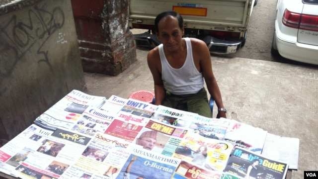 Newspaper Seller Oo Zay Yar, says all of Burma welcomes President Barack Obama's visit because of the hope he can spur economic, social, and political developments, Rangoon, Burma, November 12, 2012. (D. Schearf/VOA)