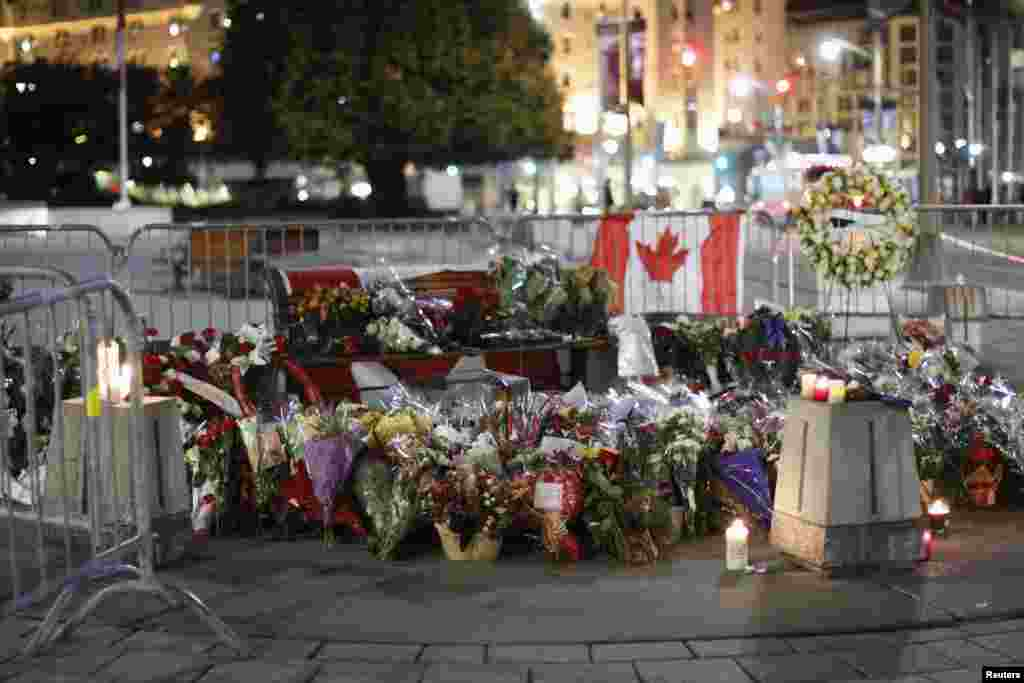People laid flowers at the memorial for Cpl. Nathan Cirillo near the National War Memorial in downtown Ottawa, Oct. 23, 2014.