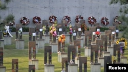 The Field of Empty Chairs is seen during the 20th Remembrance Ceremony, the anniversary ceremony for victims of the 1995 Oklahoma City bombing, at the Oklahoma City National Memorial and Museum in Oklahoma City, Oklahoma April 19, 2015. REUTERS/Nick Oxfor