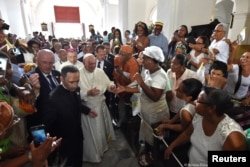 Pope Francis is greeted by faithful during a visit to the Sanctuary of St. Peter Claver, Cartagena, Colombia, Sept. 10, 2017.