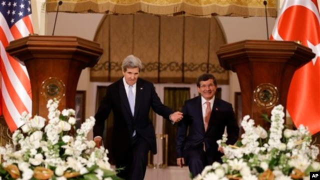 U.S. Secretary of State John Kerry, left, enters a news conference with Turkish Foreign Minister Ahmet Davutoglu in Ankara, Turkey, on March 1, 2013.