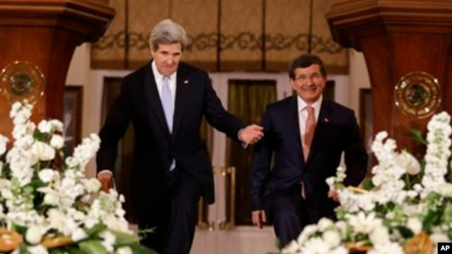 Secretary of State John Kerry, left, enters a news conference with Turkish Foreign Minister Ahmet Davutoglu in Ankara, Turkey.