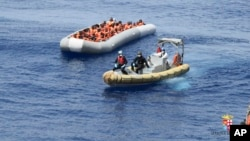 This undated image made available on May 30, 2016, by the Italian Navy Marina Militare shows migrants being rescued at sea. The Greek Coast Guard has pulled to safety 29 migrants afloat in a dinghy off the western island of Lefkada, as they headed to Italy.