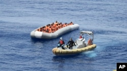 This undated image made available on May 30, 2016, by the Italian Navy Marina Militare shows migrants being rescued at sea.