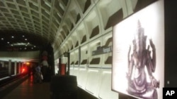 "On the metro platform, in Washington DC, a billboard highlights the ""Gods of Angkor"" exhibit."