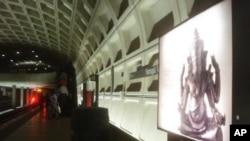 "On the metro platform, in Washington DC, a billboard highlights the ""Gods of Angkor"" exhibit."