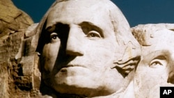 FILE - George Washington's face on Mount Rushmore.