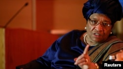 FILE - President of Liberia Ellen Johnson Sirleaf makes a point during an onstage newsmakers interview with Reuters journalist Axel Threlfall in Washington.