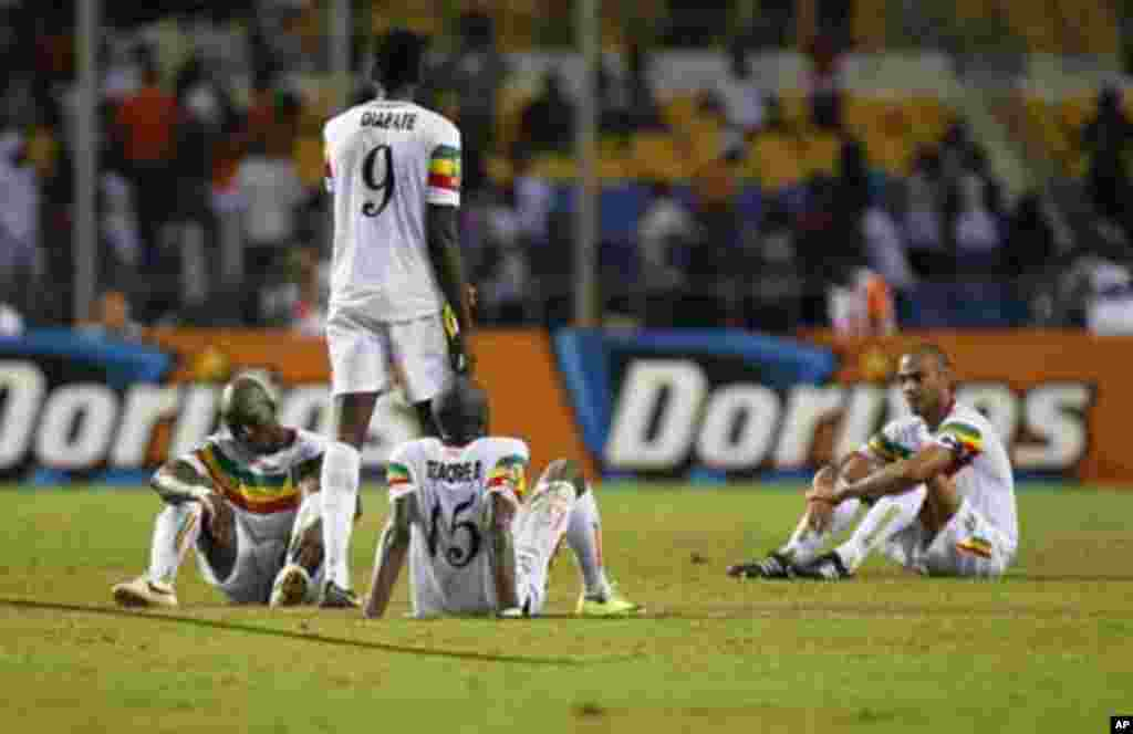 Mali's players react after they lost their African Nations Cup semi-final soccer match against Ivory Coast at the Stade De L'Amitie Stadium in Gabon's capital Libreville February 8, 2012.