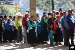 People wait to vote at a polling station during general elections in the indigenous community of Soledad Atzompa, Veracruz state, Mexico, July 1, 2018.