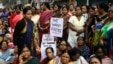 FILE - Women activists participate in a demonstration demanding highest punishment for convicted persons in the Kamduni rape case and the re-arrest of two acquitted persons near the city court in Kolkata, India, Jan. 29, 2016. Police detained three men for the rape and murder of a law student in southern state of Kerala, May 3, 2016.