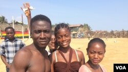 Derrick Tamba is seen with friends at a beach in Mamba Point, Monrovia, March 16, 2015. (Benno Muchler/VOA)