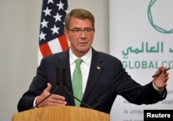FILE - Former U.S. Secretary of Defense Ash Carter attends a press conference.