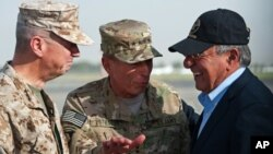 USMC Gen. John Allen, left, and Gen. David Petraeus, incoming CIA Director, greets former CIA Director and new U.S. Defense Secretary Leon Panetta as he lands in Kabul, Afghanistan, Saturday, July 9, 2011.