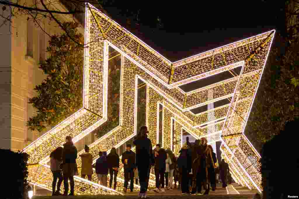 People walk under New Year and Christmas decorations in Podgorica, Montenegro.