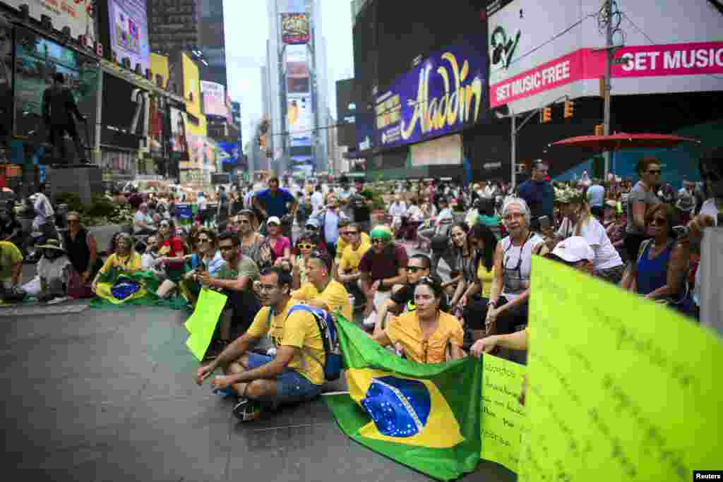 Demonstrators attend a protest against Brazil's President Dilma Rousseff in Times Square, New York, Aug. 16, 2015.