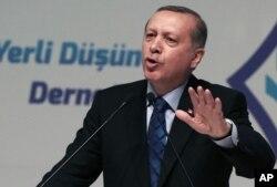 FILE - Turkey's President Recep Tayyip Erdogan addresses his supporters in Ankara, Turkey, Thursday, May 12, 2016.