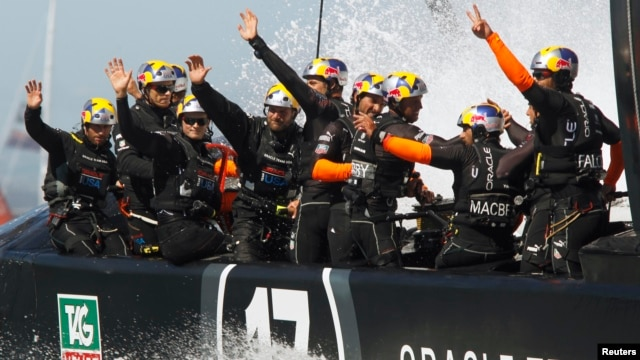 Oracle Team USA waves after defeating Emirates Team New Zealand during Race 16 of the 34th America's Cup, Sept. 23, 2013.
