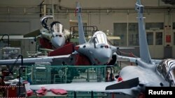 FILE - View of the assembly line of the Rafale fighter jet in the factory of French aircraft manufacturer Dassault Aviation in Merignac near Bordeaux, southwestern France, Jan. 10, 2014.